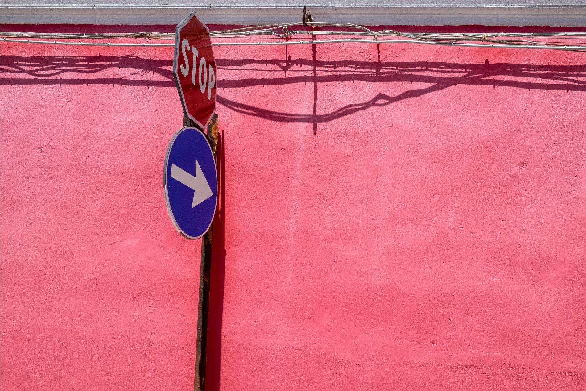 Pink wall and sign - Floridia, Sicily