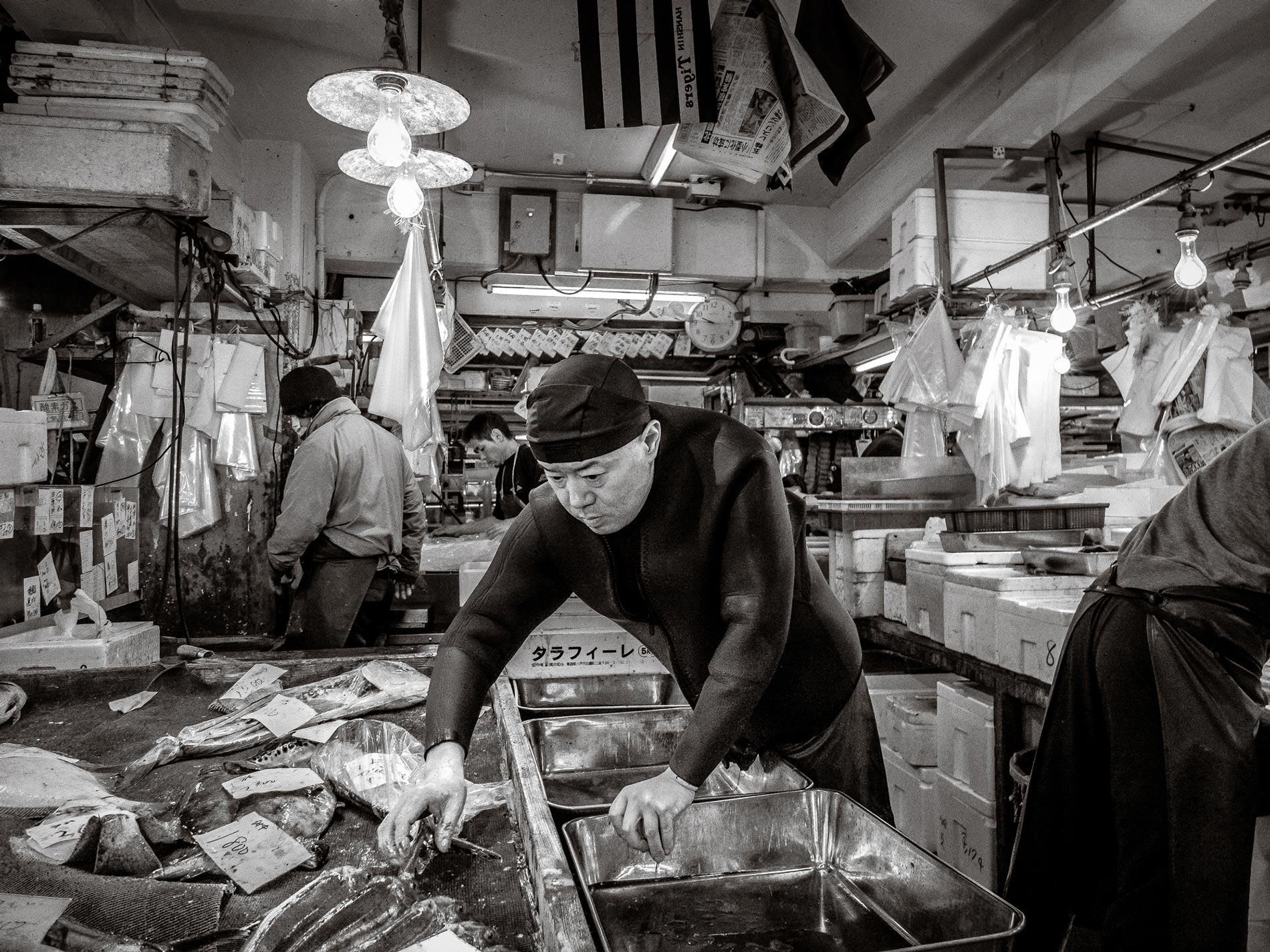 Wetsuit man Tsukiji fish market - Tokyo
