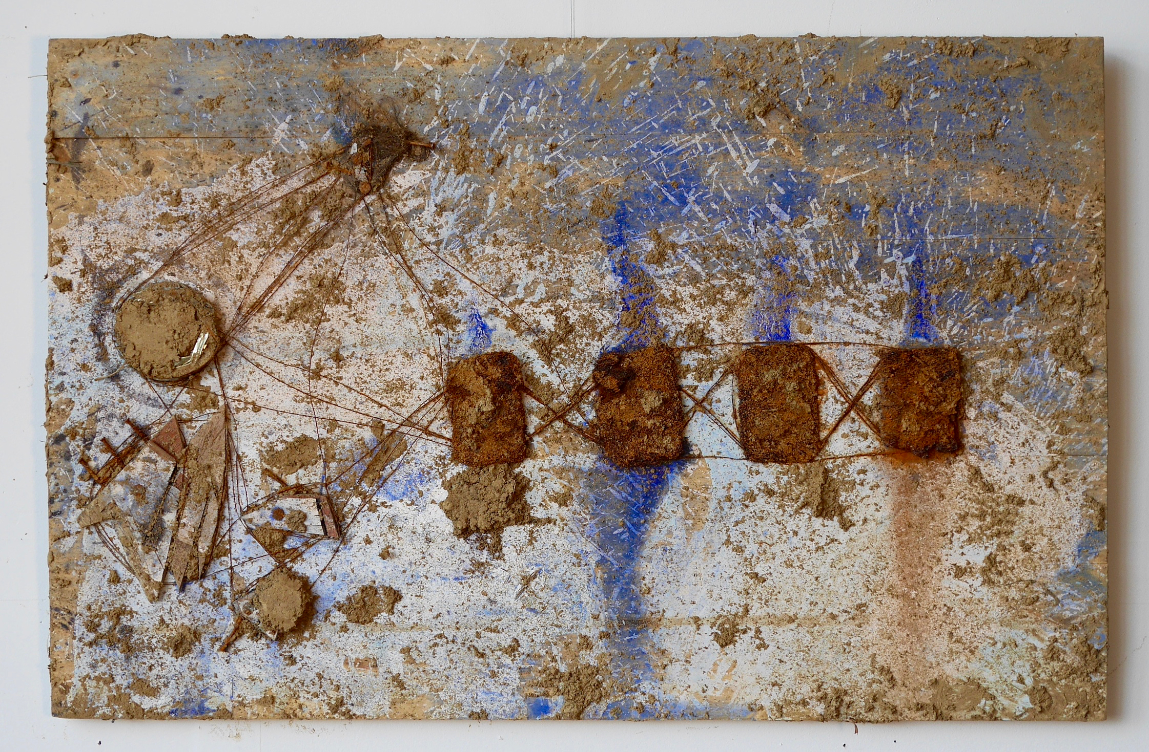 """Number 4 - What They Brought With Them  24"""" x 32""""  Hair, steel wool pads, pink glass beads, concealer, crushed can, nails, wood, acrylic, milk, vinegar, salt, ink, dye, white flour, steel wire, staples, rust, dirt, mold on wood  (2015)"""