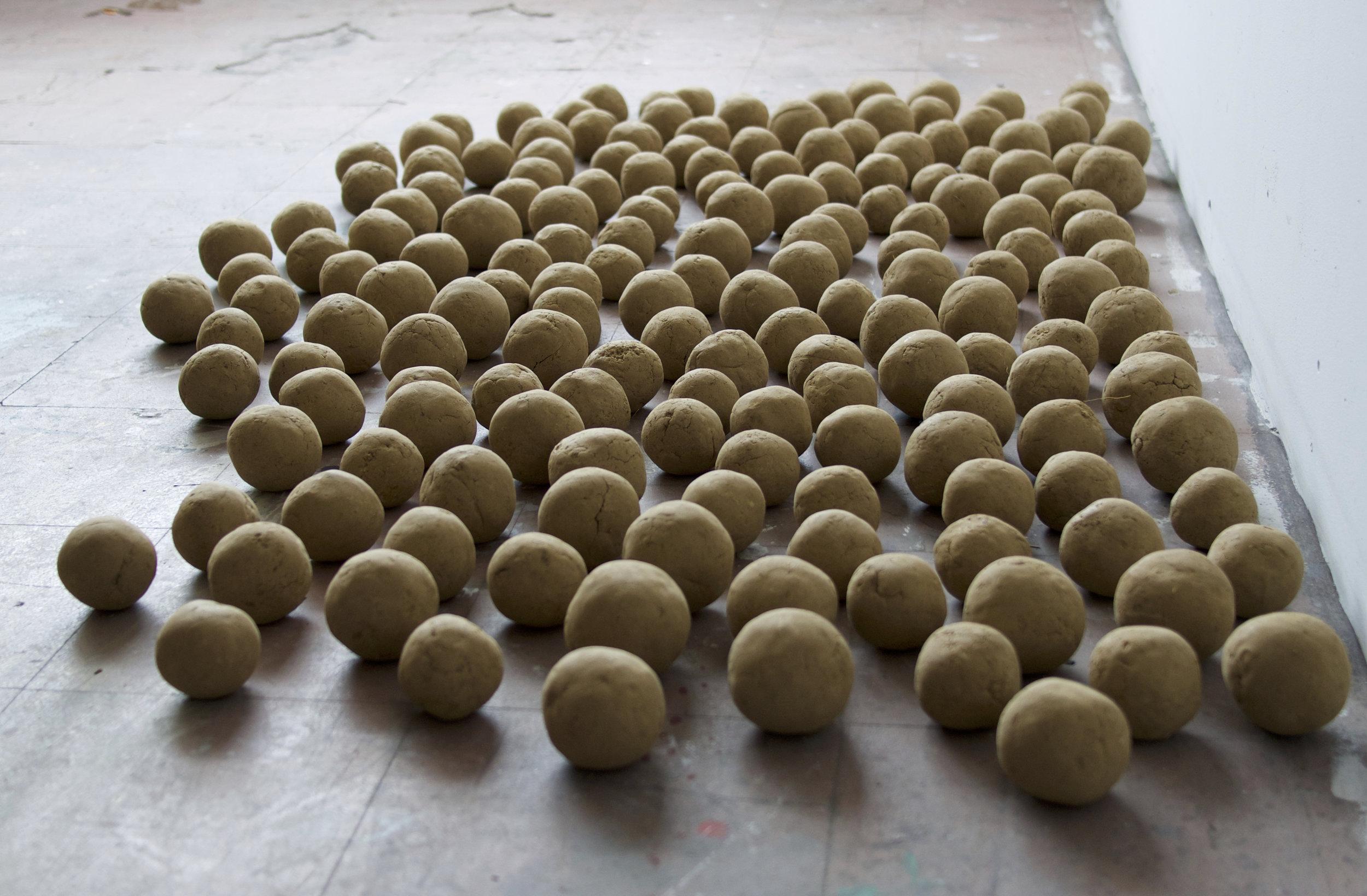 "Self-portrait, 171 Dirt Balls  Each ball 3"" - Assembled dimensions vary  Dirt  (2015)"