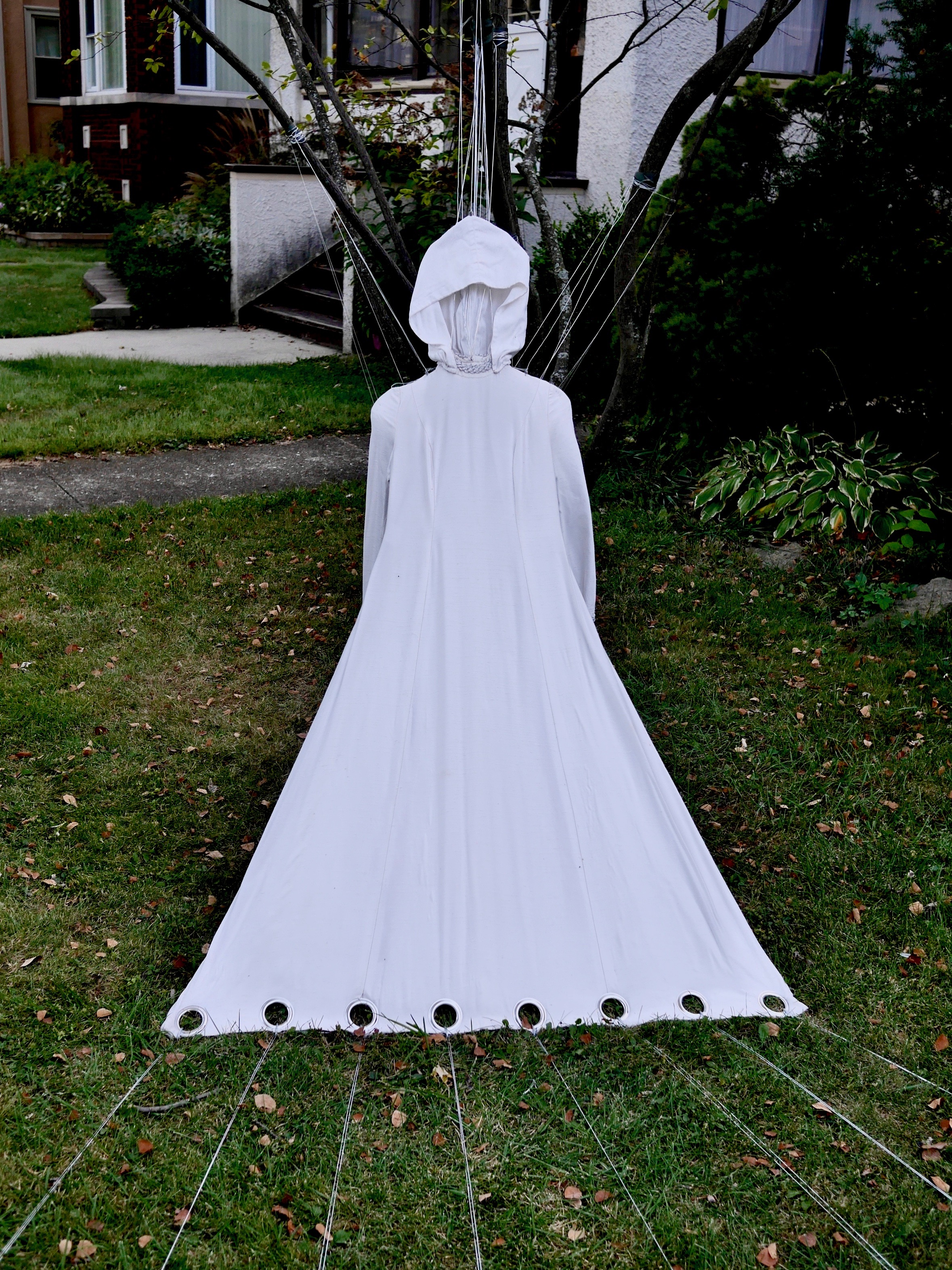 "Shelter Mother   65"" x 180"" x 100""  Vintage 1970's white dress, silver cord, wire, tent stakes  (2017)"