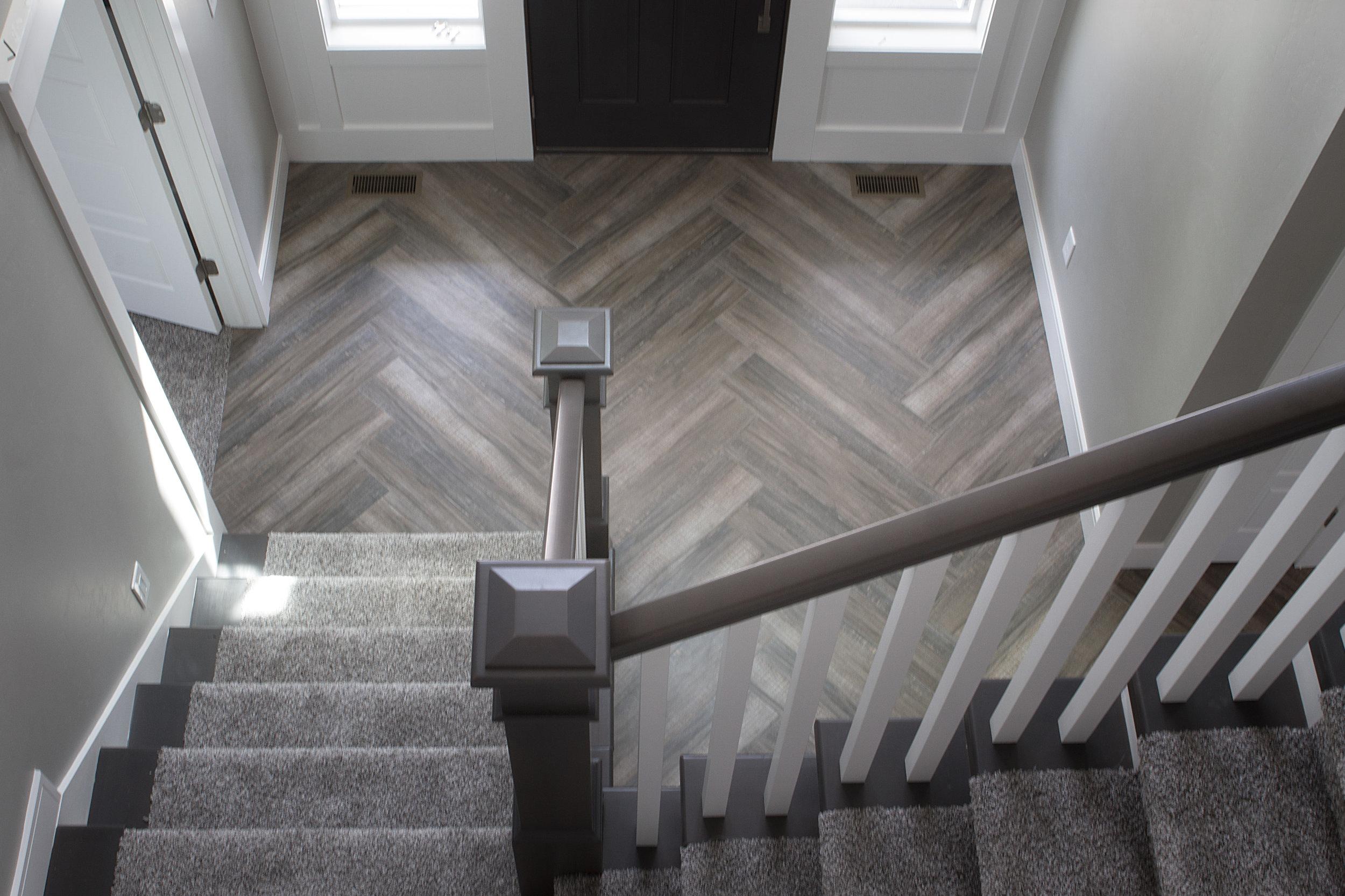 Herringbone Wood Texture Tile Floor Installation Kitchen Entry