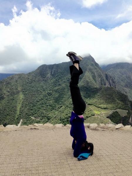 Photo credit: Robert Maschke. Headstand by Yan Maschke on the top of Machu Picchu Peru (8000 feet) in December 2014.
