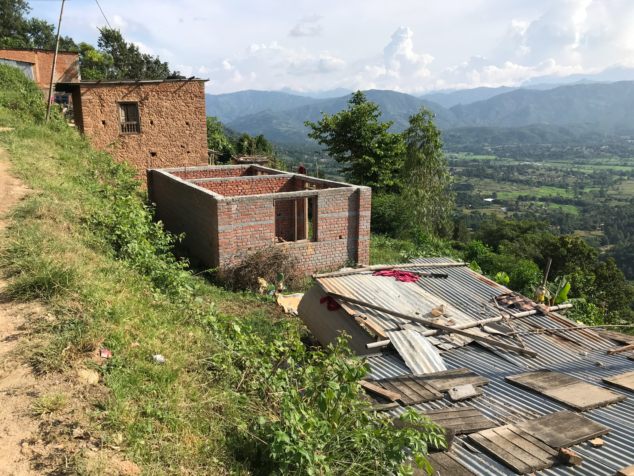 Houses showing the stages of reconstruction, taken from recent field interviews Panchkhal Municipality, Kavrepalenchowk District by Jamie McCaughey