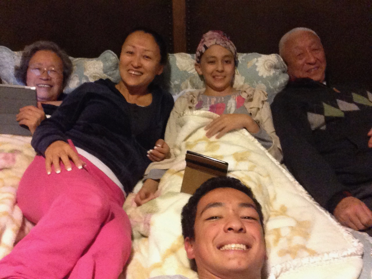Our whole family in bed after Noah was discharged, though she was still going through Chemotherapy at the time.