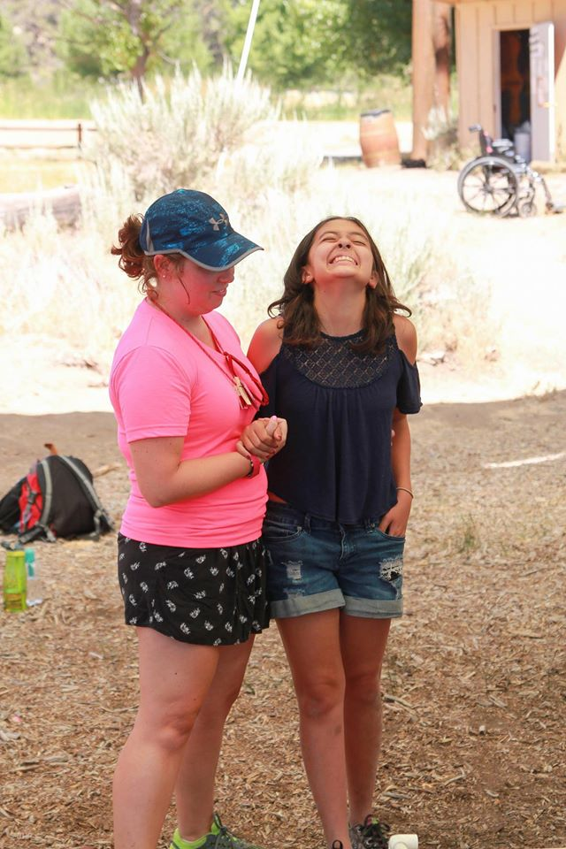 Noah at camp with her counsellor goofing about.