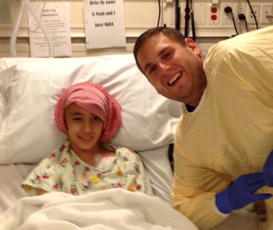 Noah in the hospital, smiling for a picture with the legend Jonah Hill, though she was too young to know who he is from any of his movies.