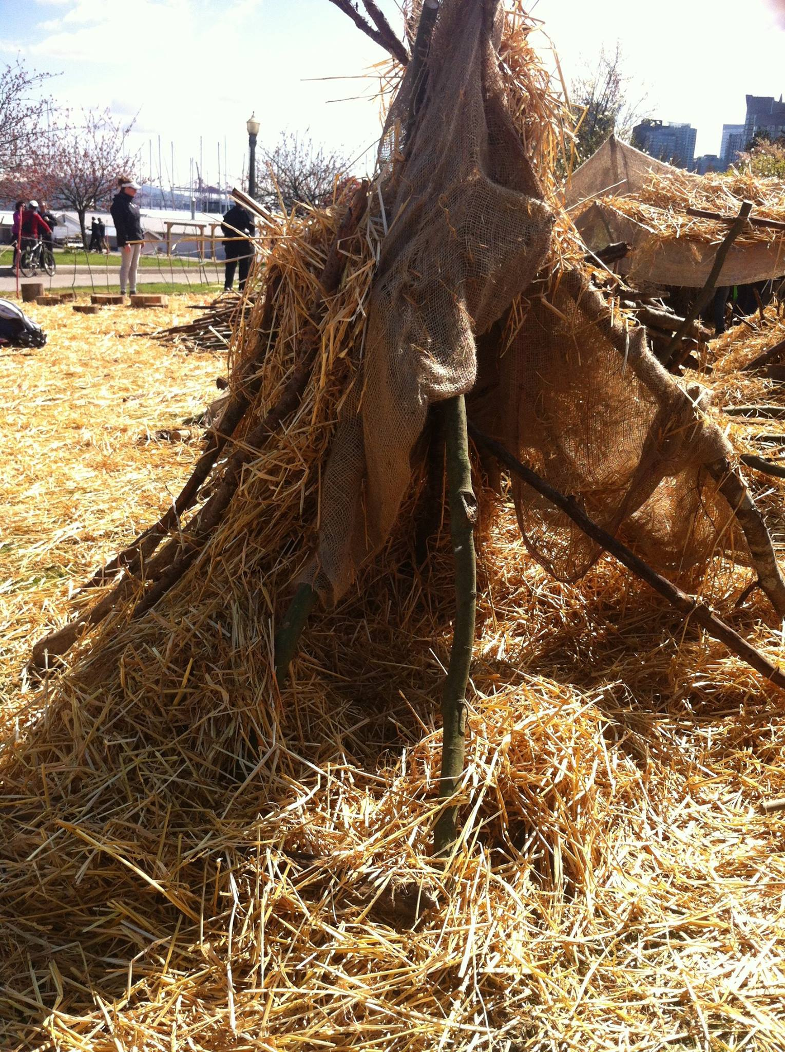Huts at the pop up playground by Bienenstock Natural Playgrounds - Vancouver