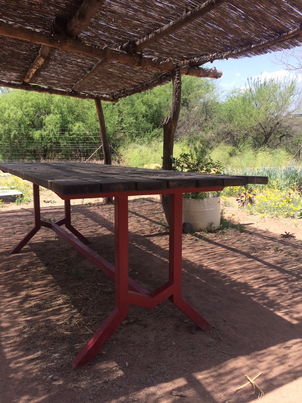 garden table under rustic ramada