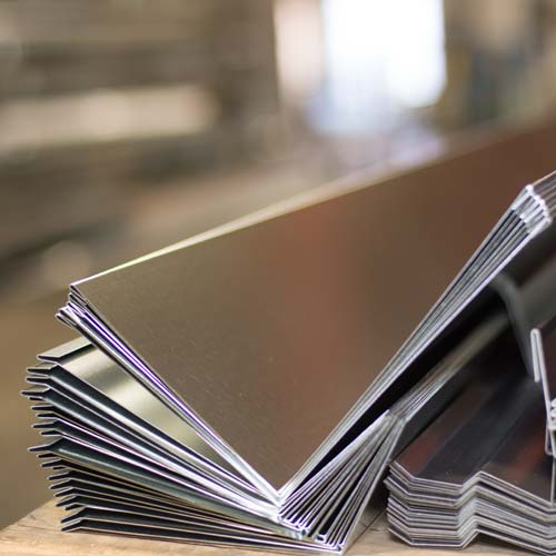 Metal Forming - + Custom bending and flashings + Galvanized and pre-painted bars + Back pans + Gutters and downspouts + Up to 10' lengths + Up to 14 GA