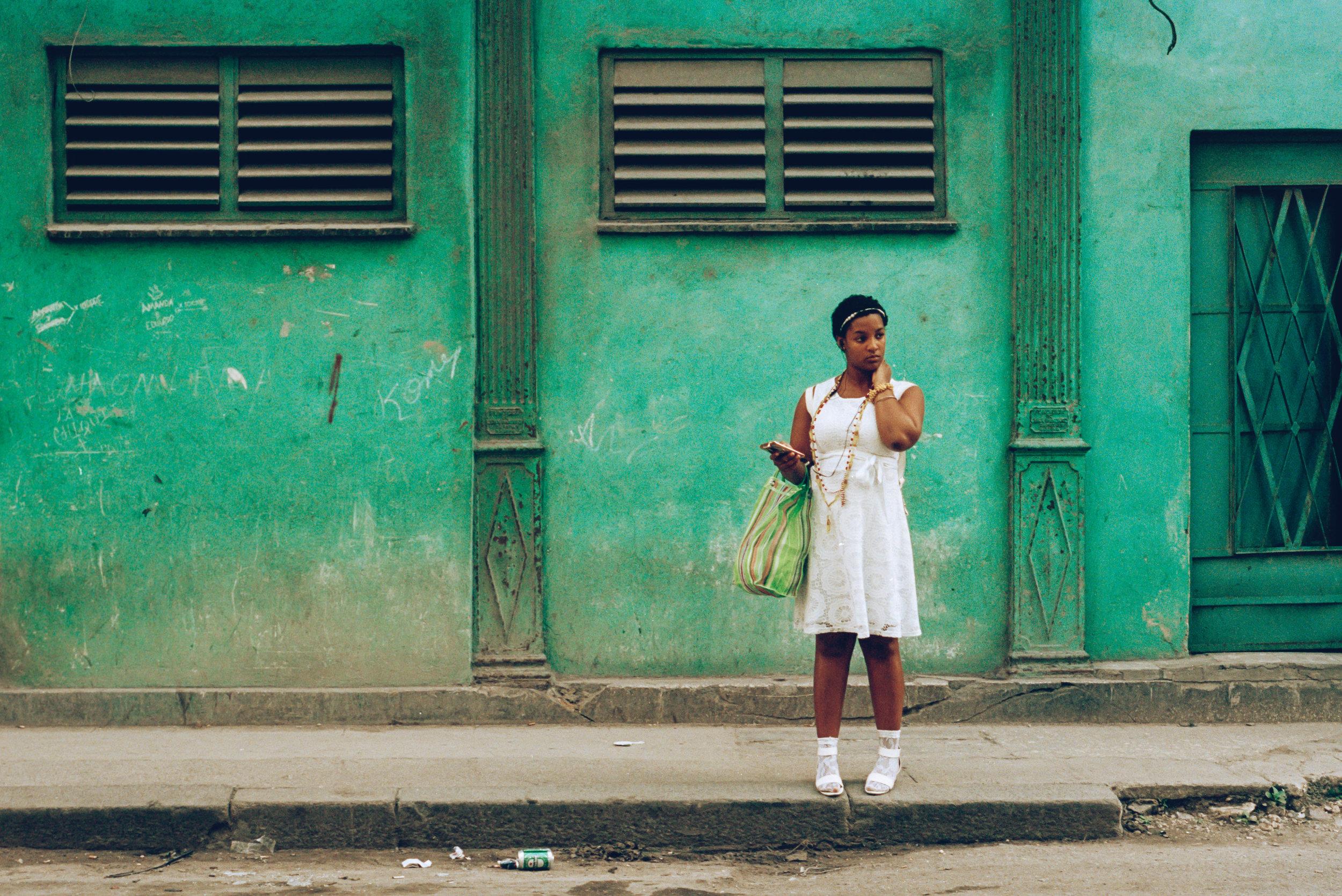 93120009 cuba havana woman green wall.jpg
