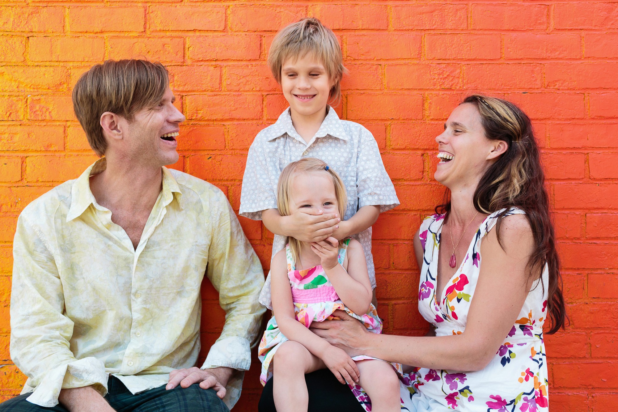 family laughing during a lifestyle family session with shannon roddy in brooklyn ny