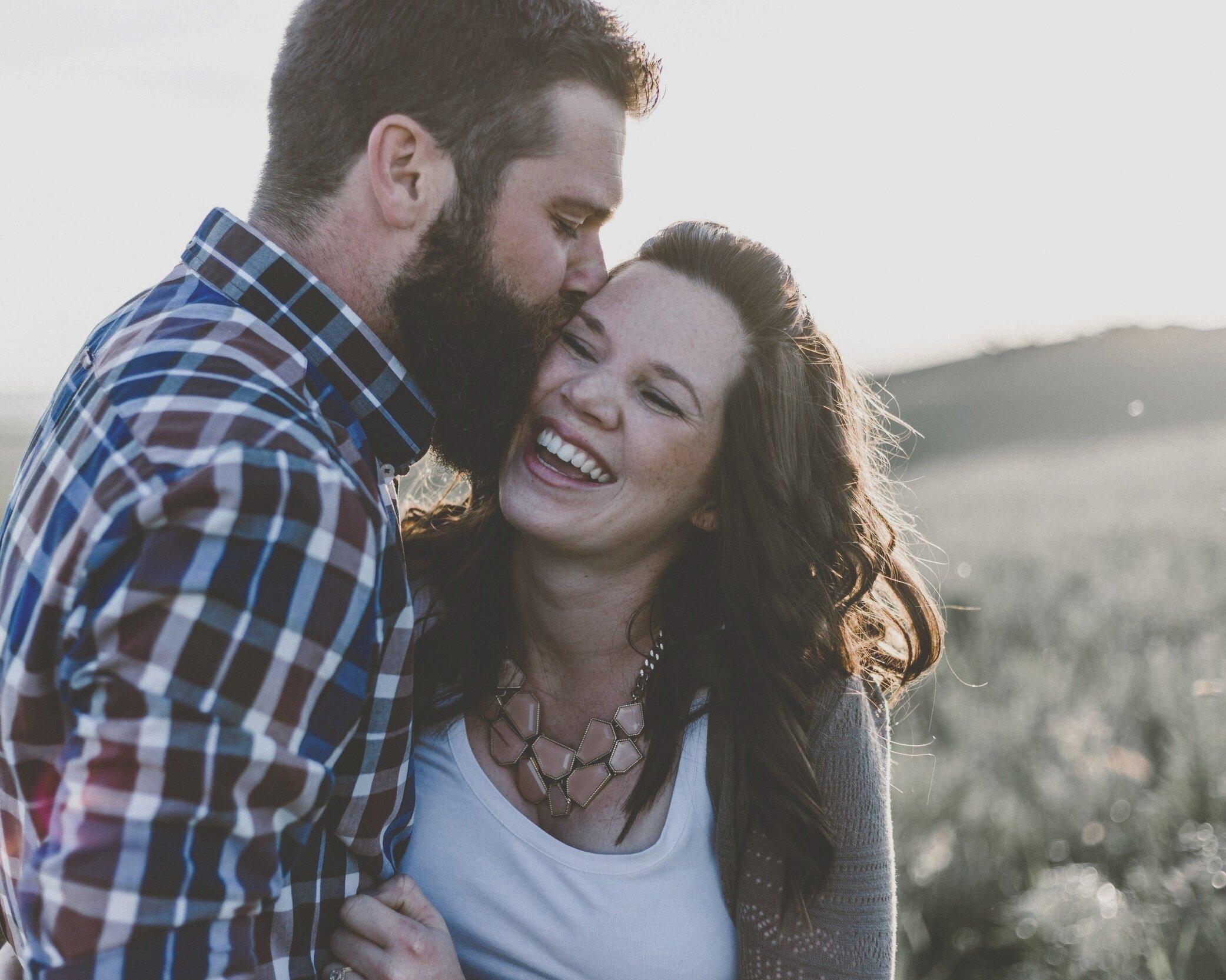 beard_smile_couple_in_field_priscilla-du-preez-318422-unsplash.jpg