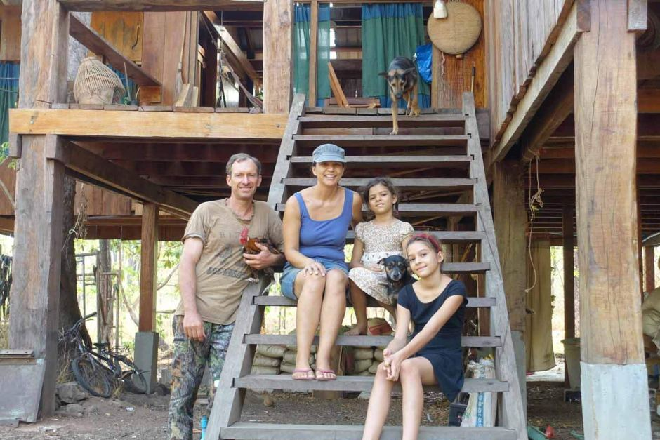 Ben and Sharyn Davis, with daughters Jarrah and Amelie, at their home in Phnom Tnout forest. (ABC News: Alice Cuddy)