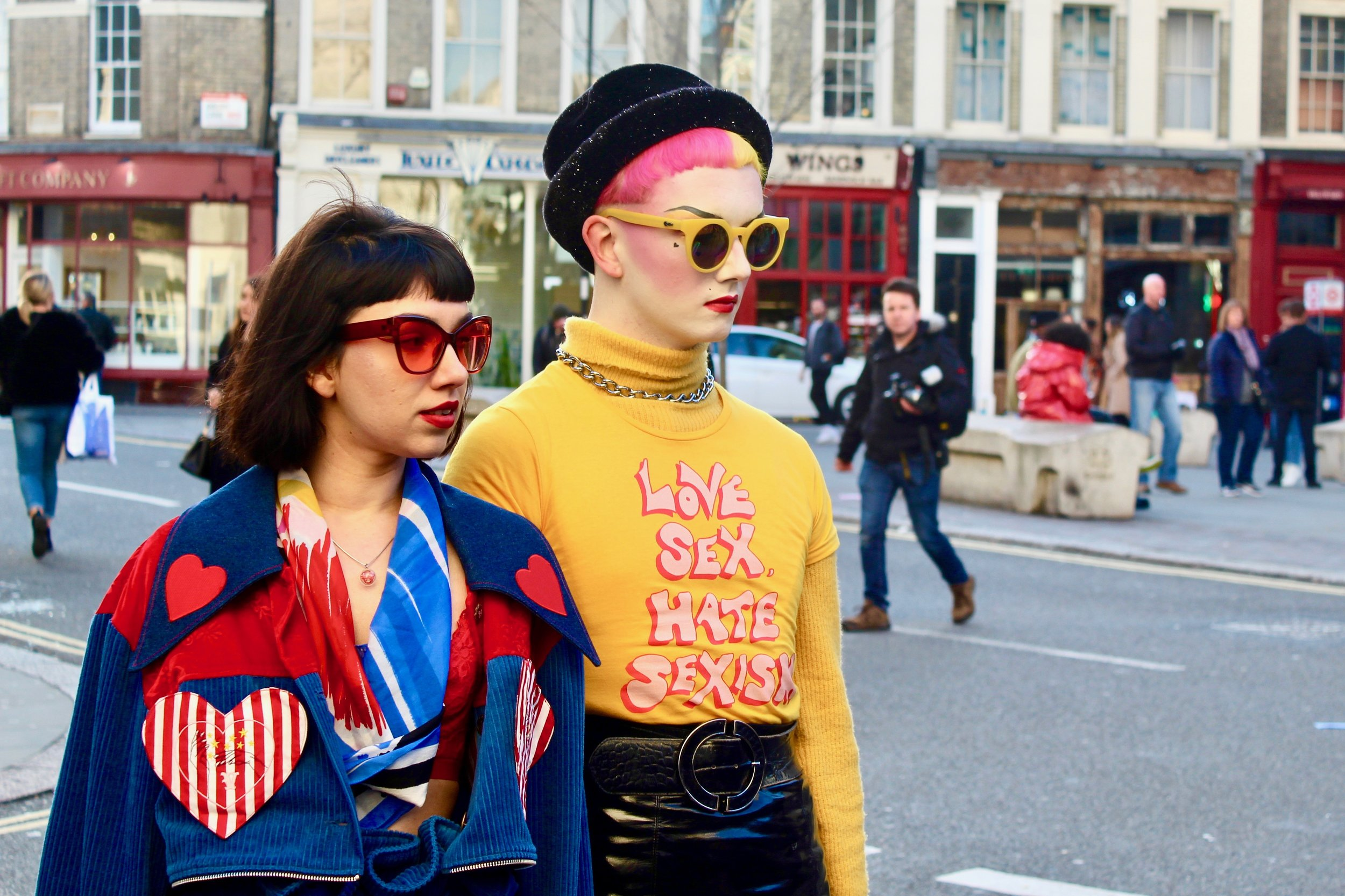 Feminist Fashionistas posing outside the venue