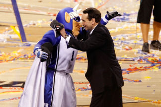 Coach K & Blue Devil share memorable moment - Pictured above is Coach K and The Blue Devil hugging in happiness after a NCAA championship win.