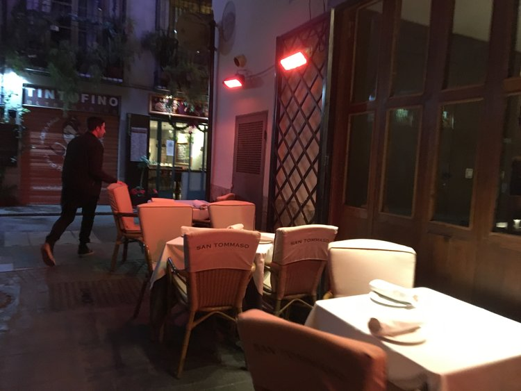 I still sat outside for dinner in January. There were heat lamps everywhere. This is outside San Tammosso