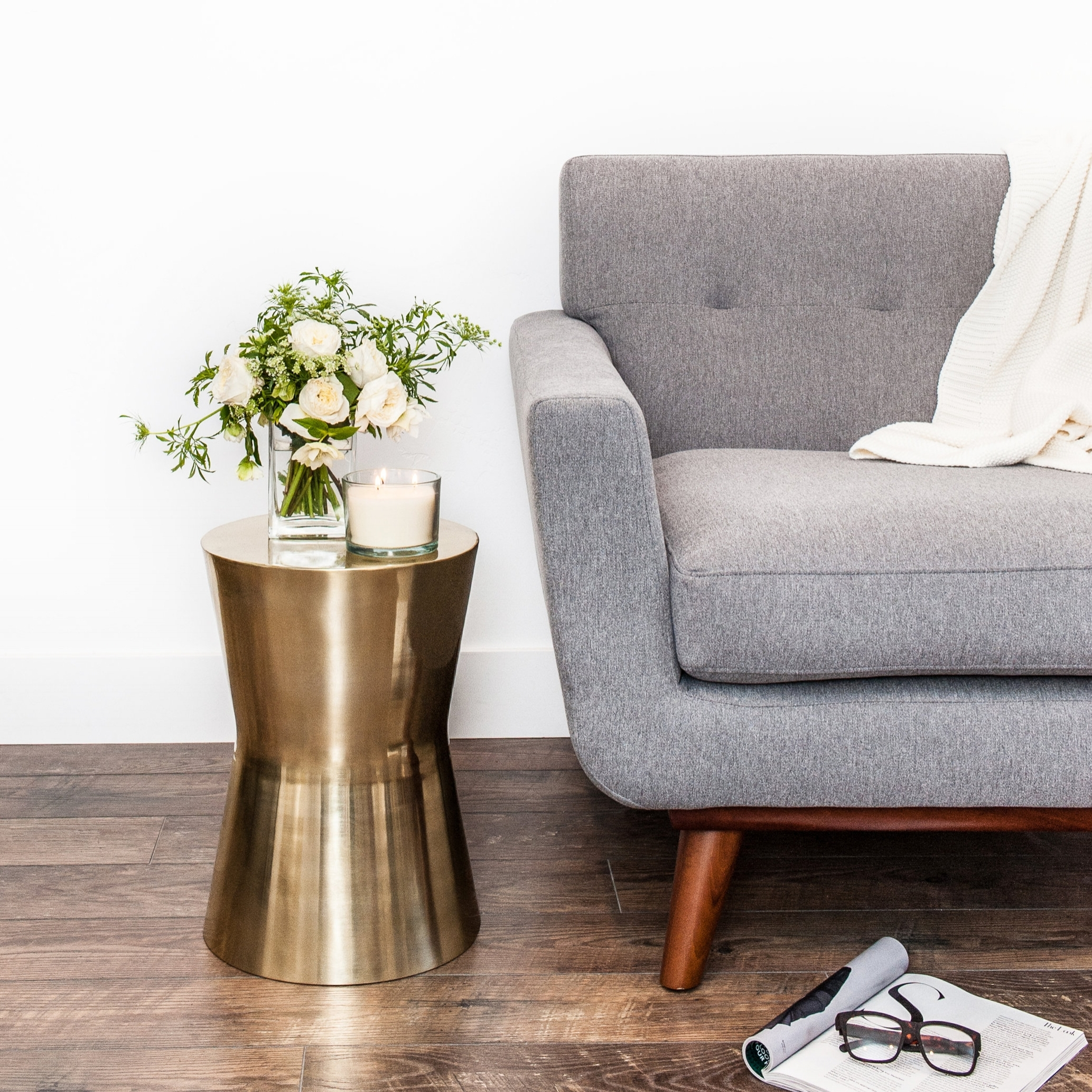 Grey Couch with Flowers and Candle.jpg