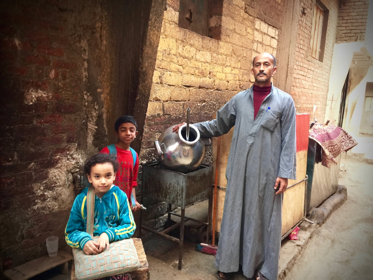 Mohammed and his kids show us his original felafel mixer, purchased with a TOLI microloan over a decade ago.
