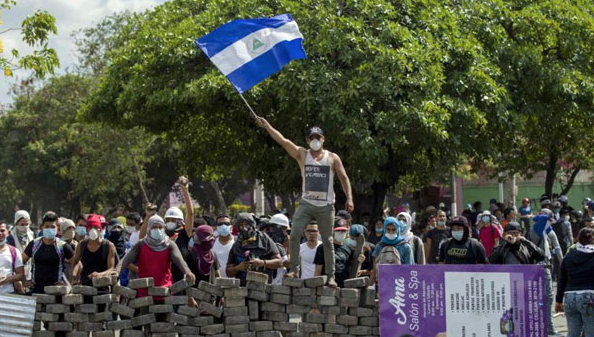 THE BAD NEWS: For the past three months,  a police crackdown on civilians  protesting Nicaragua's government have led to hundreds of deaths, charges of human rights violations, and an economy at a total standstill. (Photo Credit: BBC News)