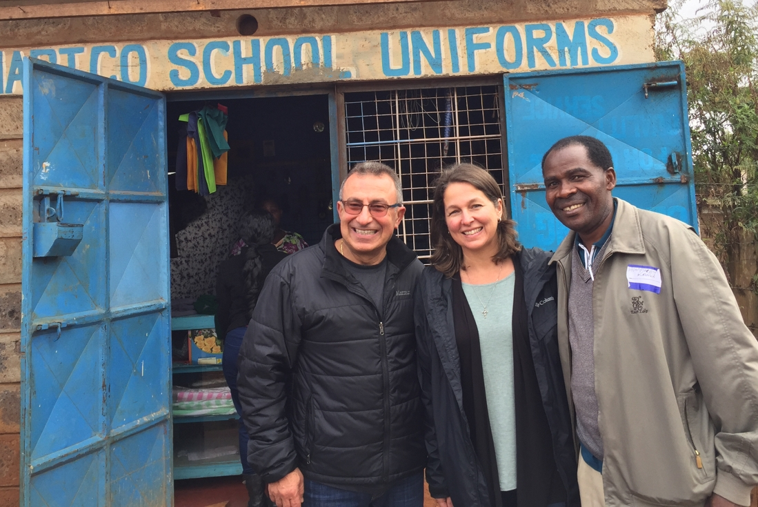 Humphrey Kanga (right) with TOLI Founder Emad Yassa (left) and Executive Director Abigail McConnell (center) visiting a client's business in Kenya.