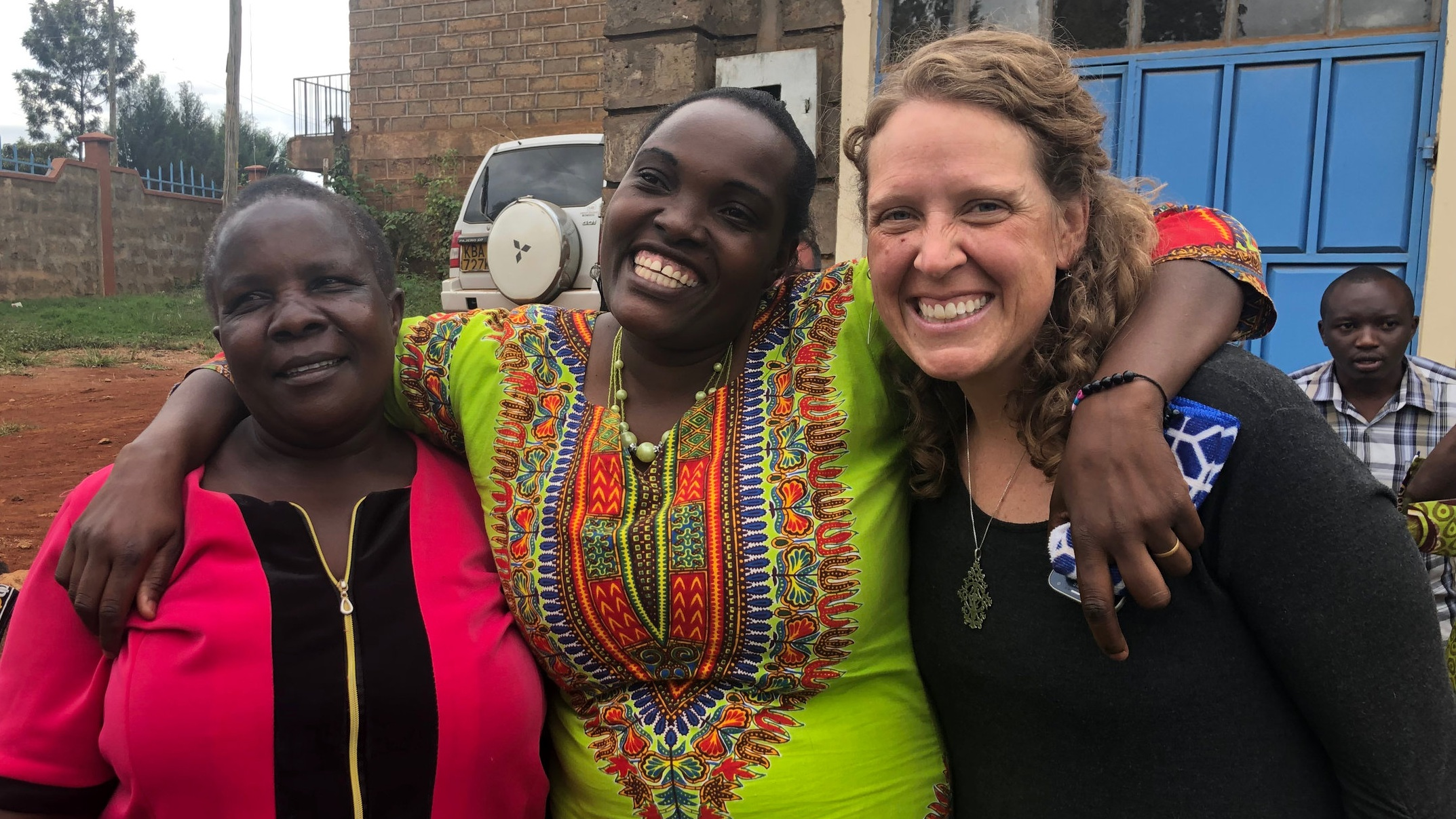 Erin (right) with client Rose (center), who's building a dressmaking business with a $300 TOLI loan.