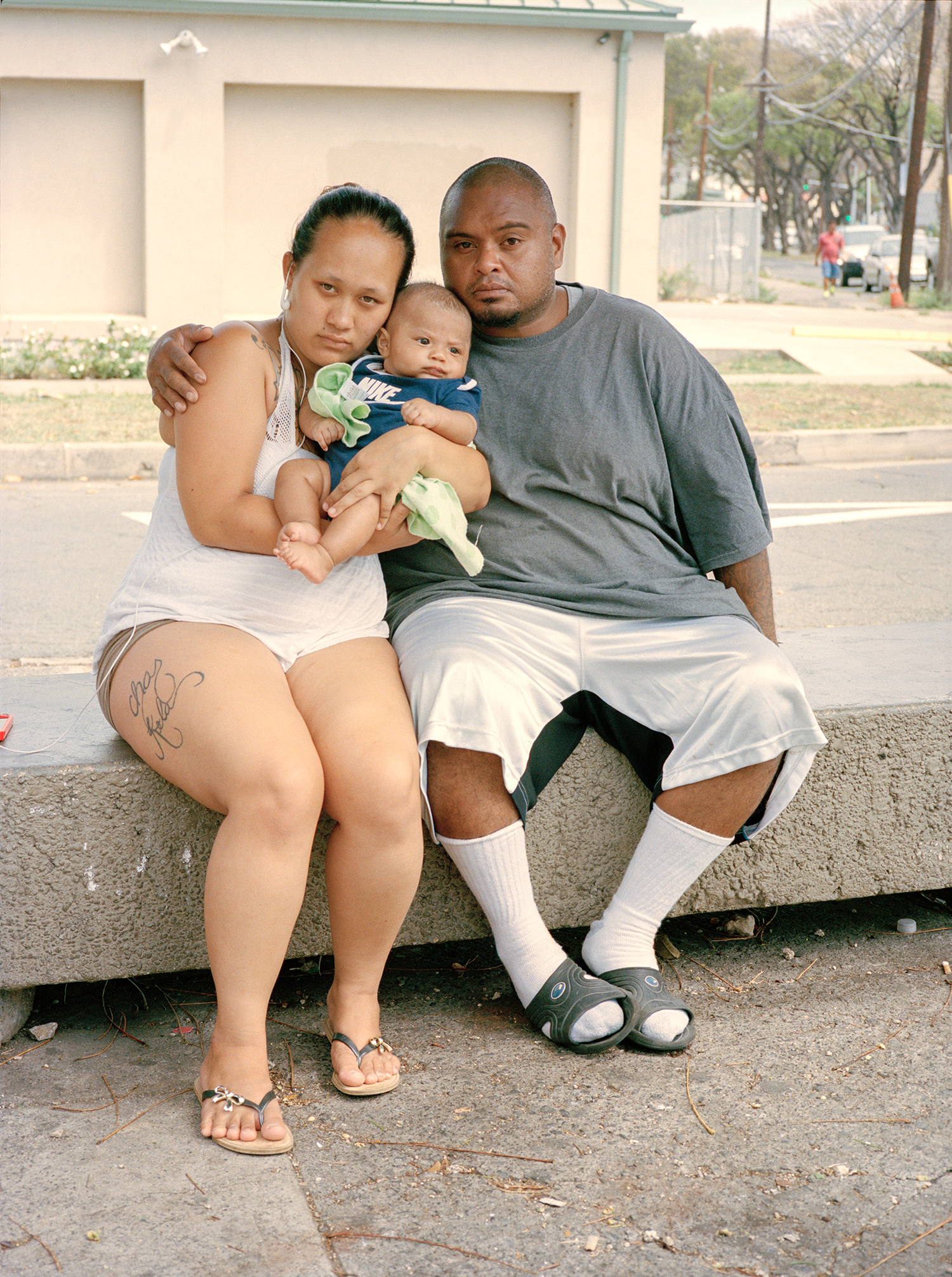 Chas, Kela, & Baby at Bus Stop Outside Micronesia Mart - Oahu, HI 2014