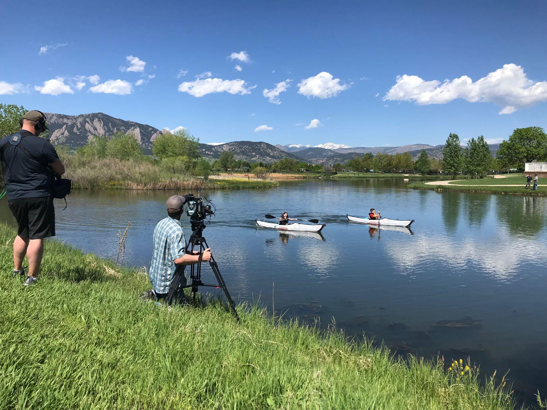Tom Miller filming Cameron Keith kayaking for ESPN