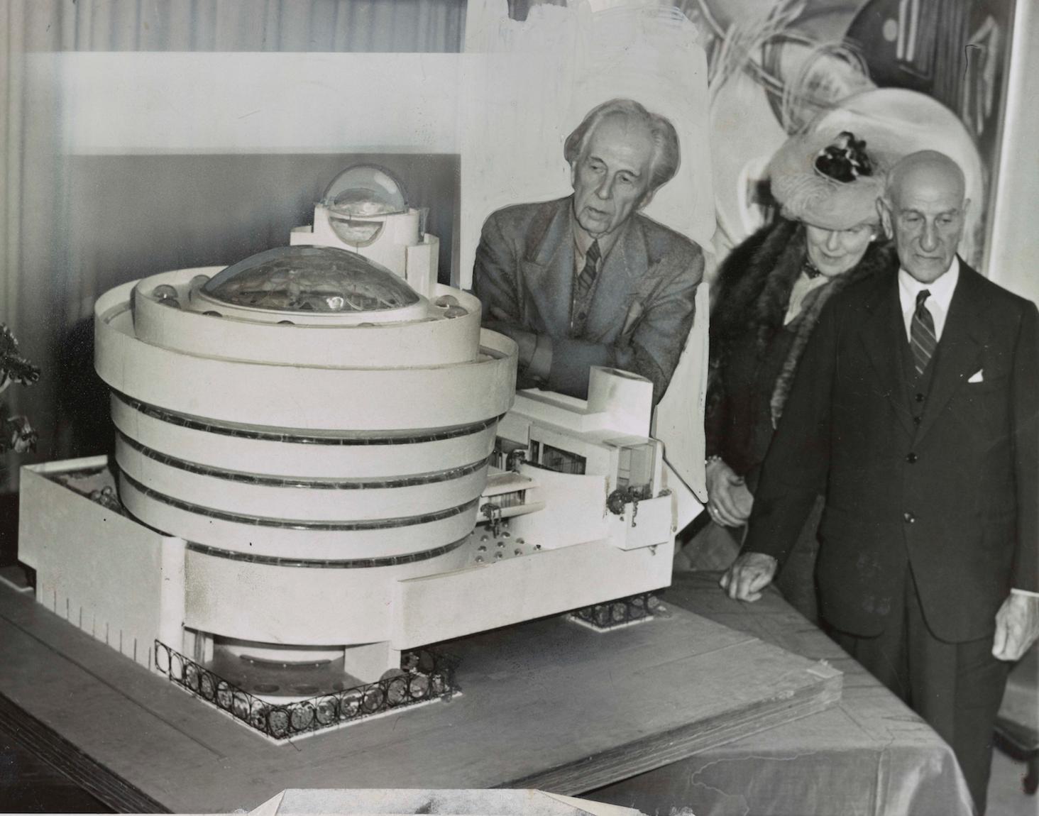 Model of the Guggenheim Museum, Frank Lloyd Wright (left), Hilla von Rebay, and Solomon R. Guggenheim, September 12, 1945.  [Public domain. Courtesy of Library of Congress.]