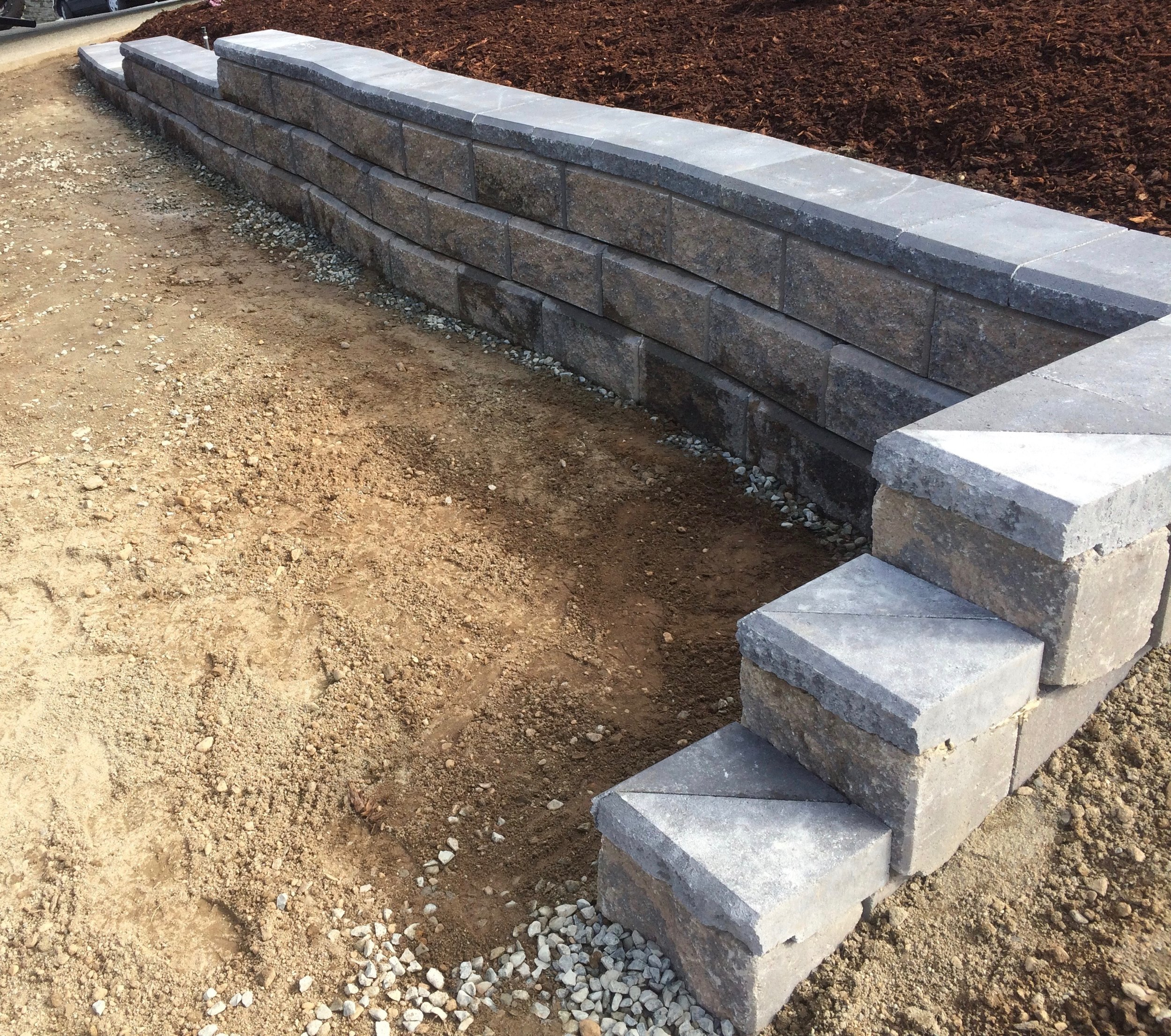 jinglepot landscapers - curved allan block wall
