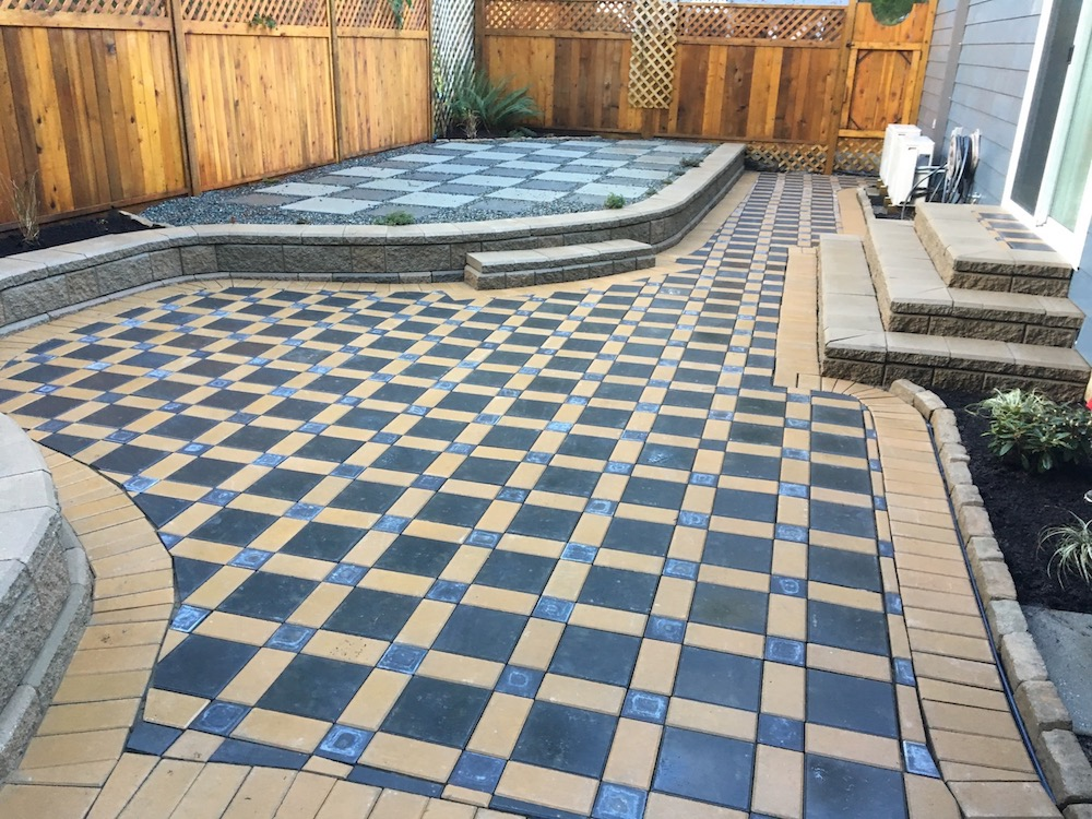 larger paver patio and curved allan block wall - jinglepot landscaping - nanaimo