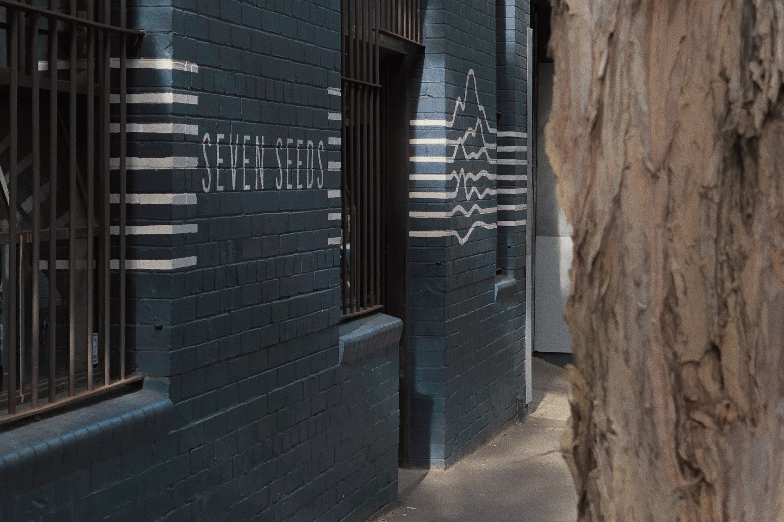 Seven Seeds - Coffee, Interior DesignMelbourne, AustraliaSeven Seeds takes its name from the precious cargo which Baba Budan smuggled out of Yemen and into India during the 17th century. By strapping seven seeds of fertile coffee to his waist, Brother Budan broke through the tightly regulated system which had, until then, kept coffee cultivation within the confines of the Arabic world. Because of Baba Budan and his determination to spread coffee around the world, we are now able to source beans from the Americas, Africa and Asia.