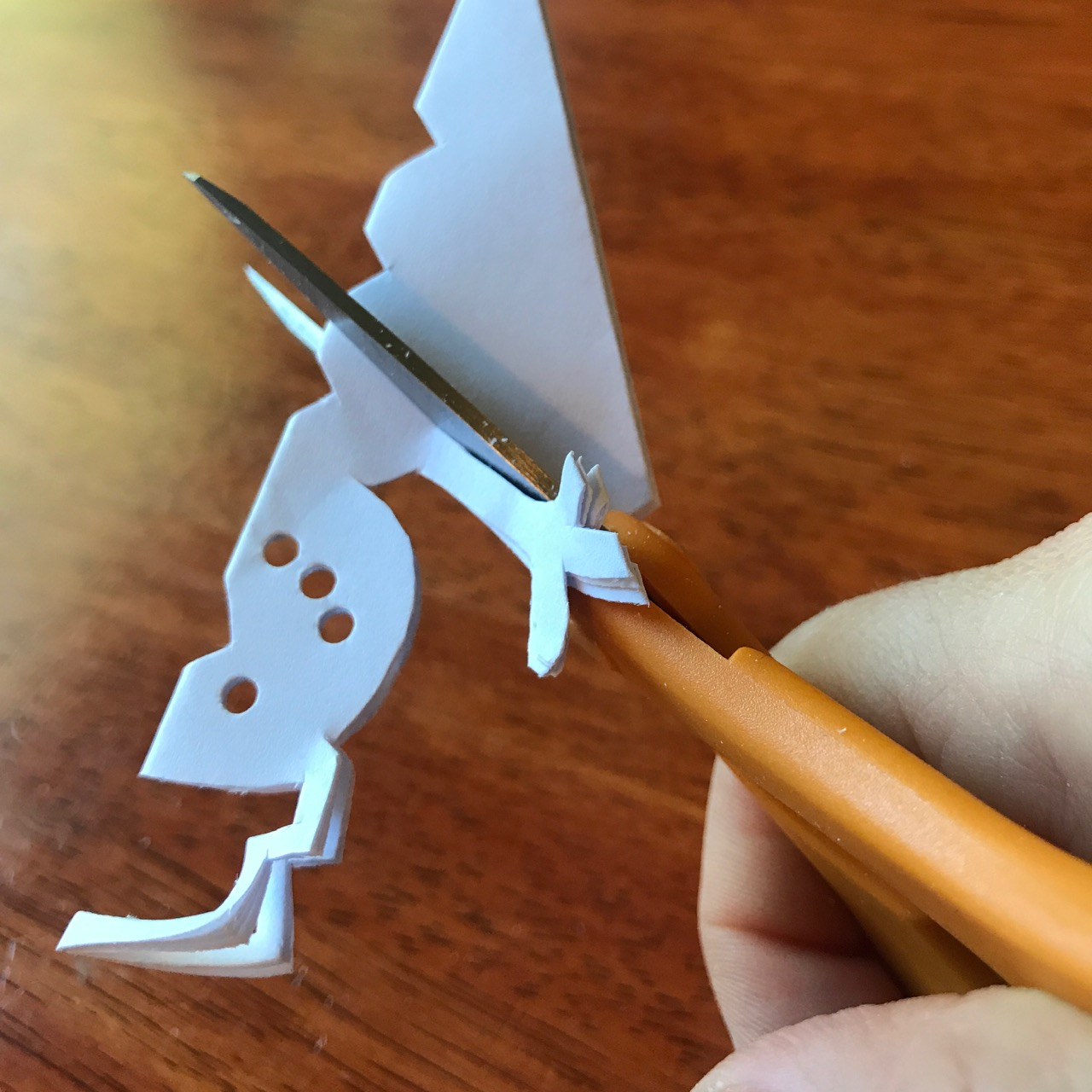 How to cut a snowman paper snowflake