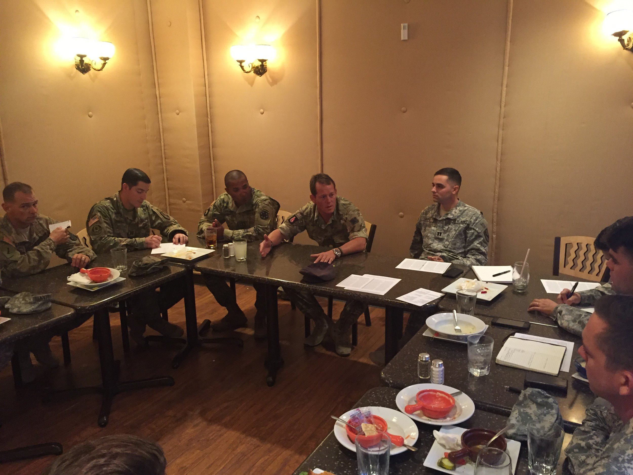 The Irwin Drink and Think meets for lunch at a local restaurant on post. A British Army Major describes the British Army's operations process.