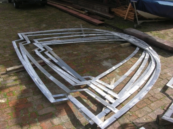 These frames will soon be set in place to start defining the shape of the hull and deck.