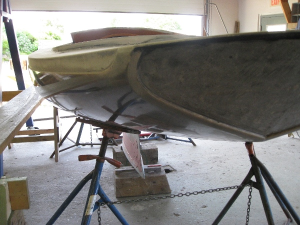 The varnished wale and transom will be skillfully set into recesses in the hull for a flush appearance similar to a wooden boat.