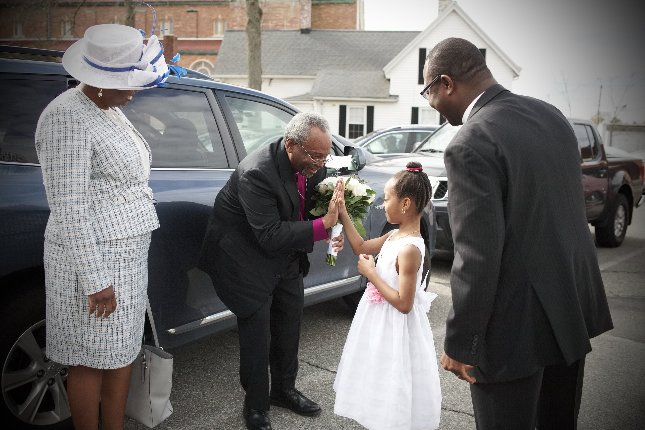 Bishop Curry is greeted by a young parishioner of Grace Chapel