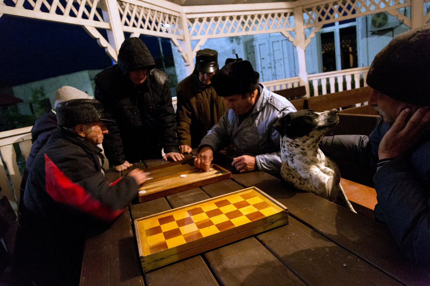 Sulina, Romania,November 2017. Men playing in a gazebo in the center of town.
