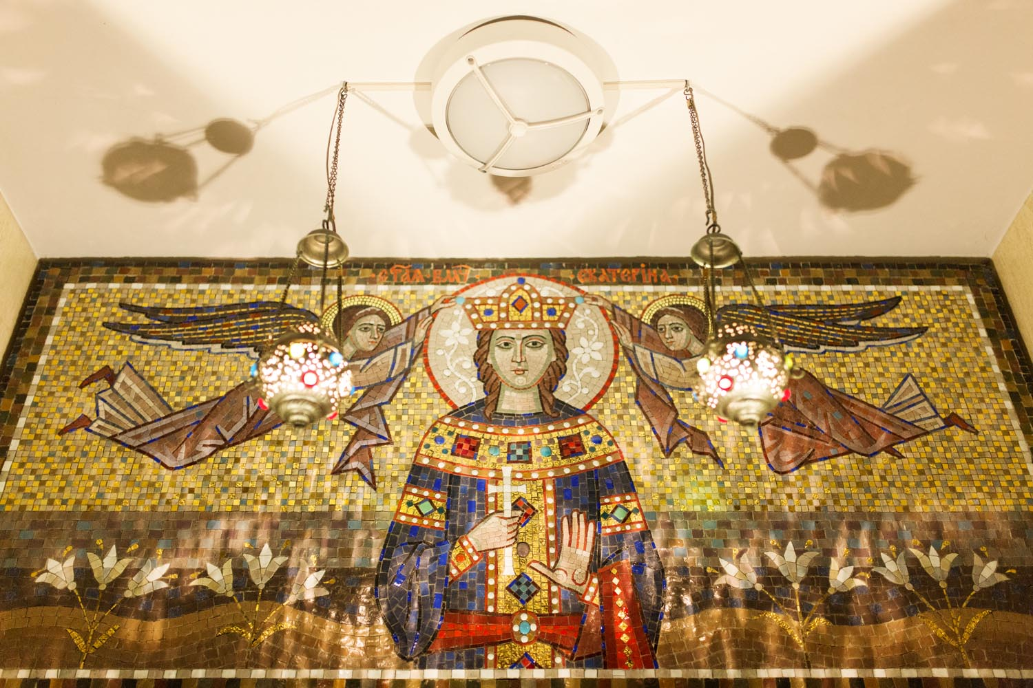 Rome, Italy, Apr 2018.  Mosaic of Saint Catherine Martyr, upon the entrance to the first floor of the church building.