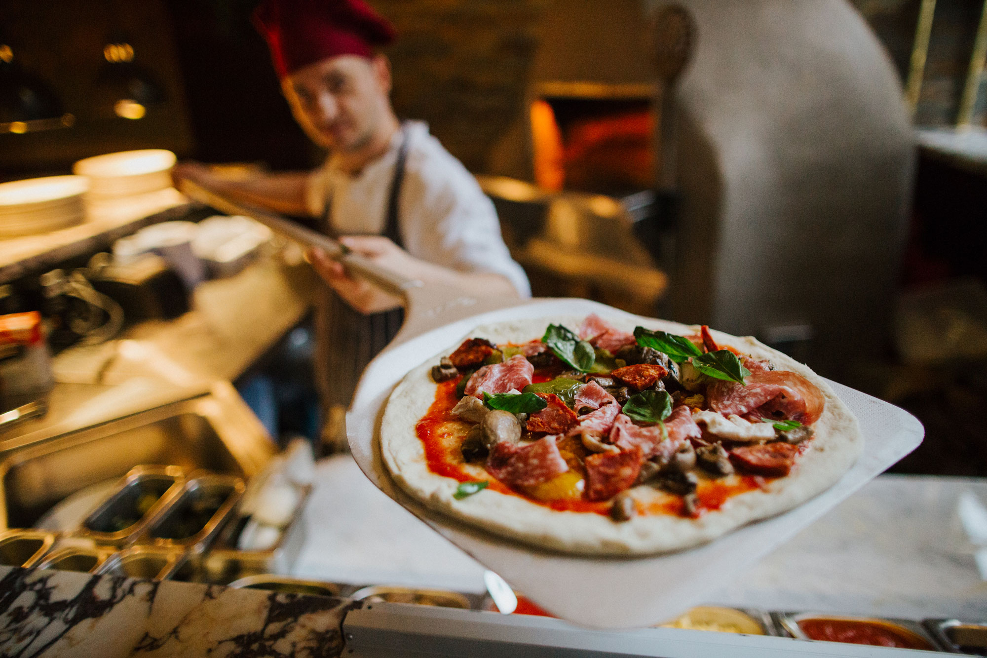 Pizzaiolo with wood-fired pizza at The Globe pub, restaurant and hotel in Warwick.jpg