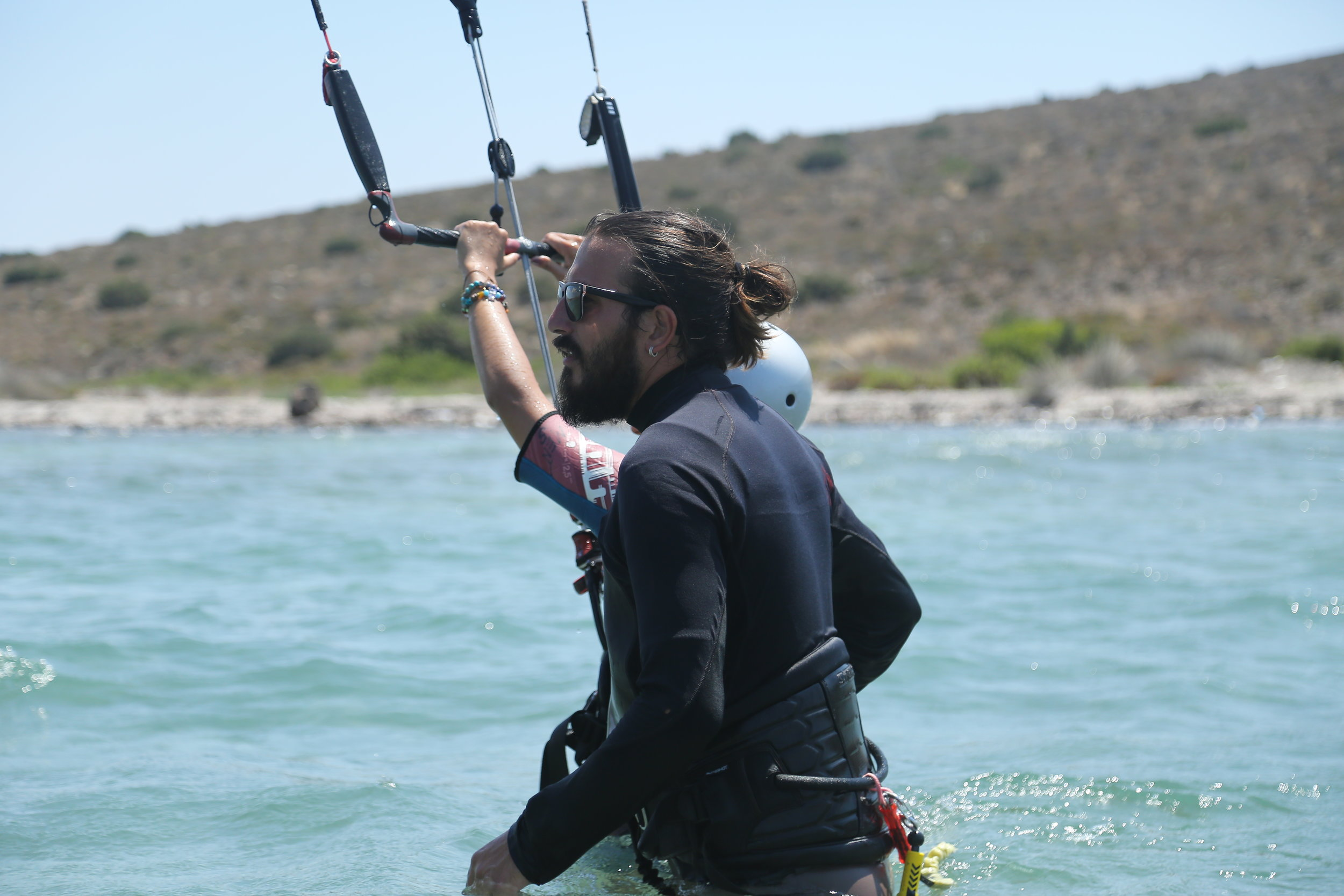 - Kitesurfer since:2015Licensed instructor since:2016Languages:TurkishHe has always been a passionate nature love, in 2010 first he had started with paragliding. For long years of paragliding, he has been into quite a lot competitions and he had traveled long miles of flying. He has been a paragliding asistant instructor, and then he started kiteboarding in 2015. He had progressed quite quickly thanks to his paragliding experience, and he has been a kiteboarding instructor in 2016. After working a full season in Kite Club Urla, he keeps teaching and sharing his expertise in Advance Kiting.