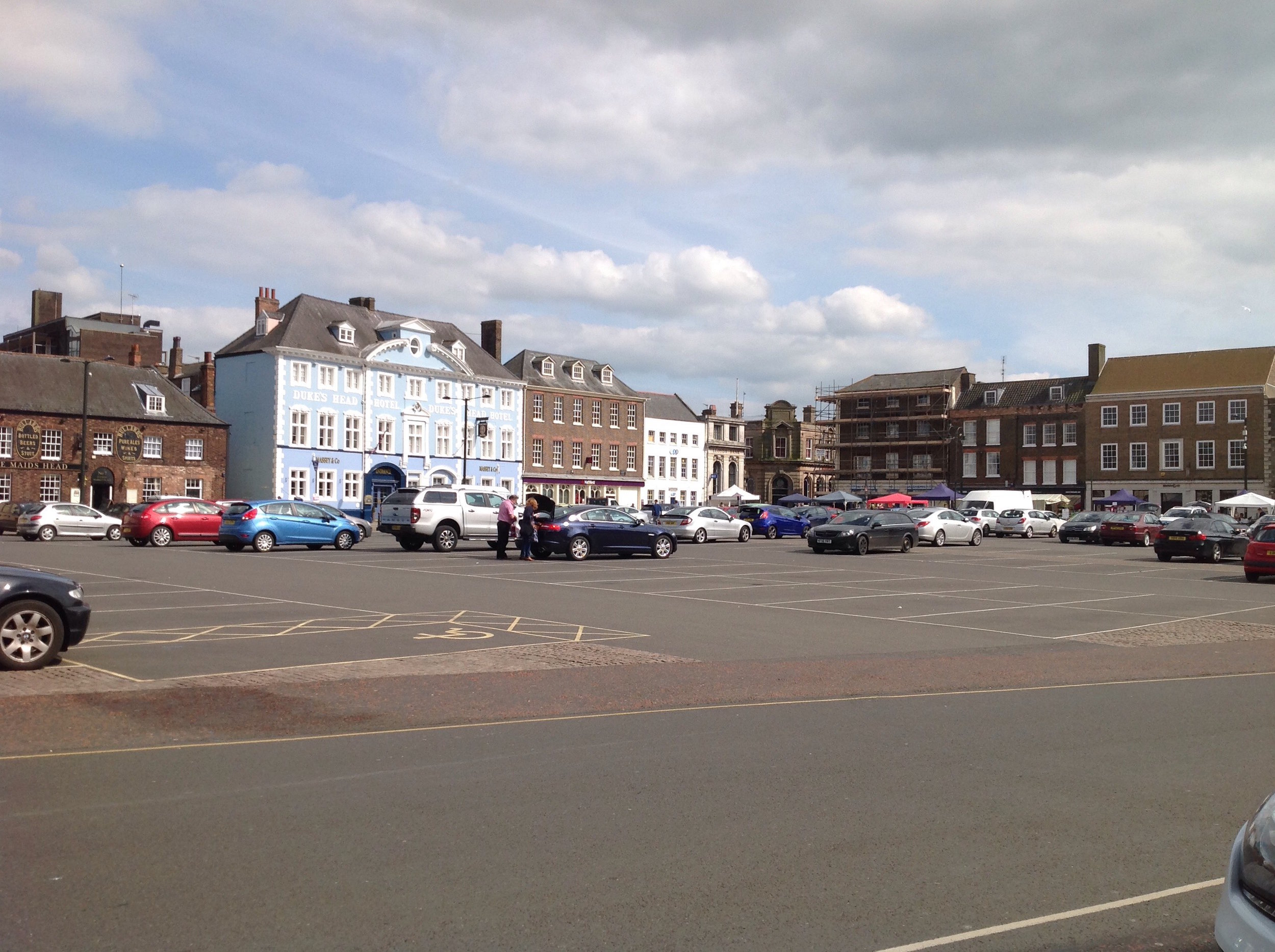 Tuesday Market Place looking towards the Duke's Head hotel. This area is now largely car park, with a few market stalls every Tuesday at the south end nearest to the high street.