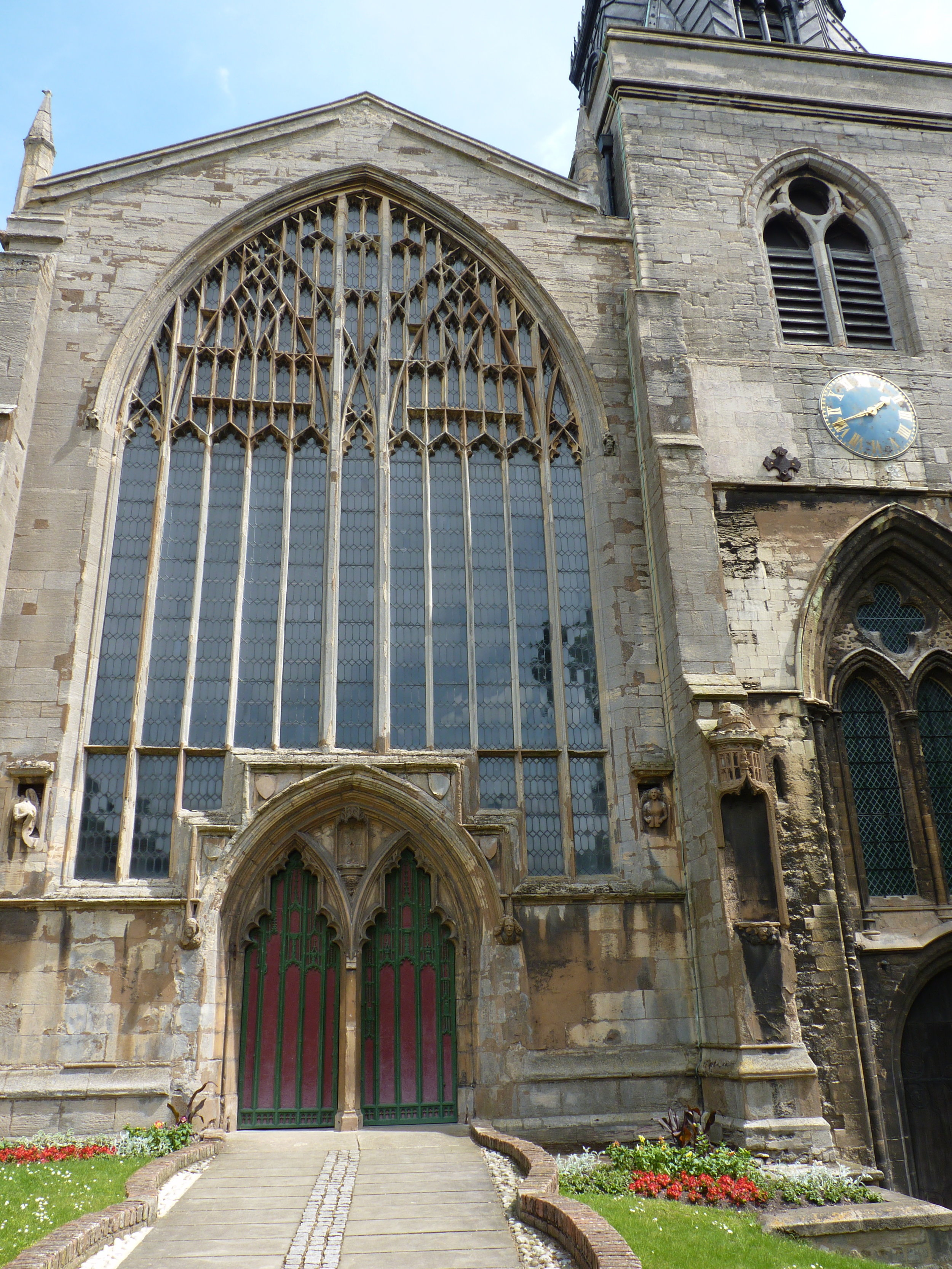 The facade of St Nicholas with its magnificent west window tracery