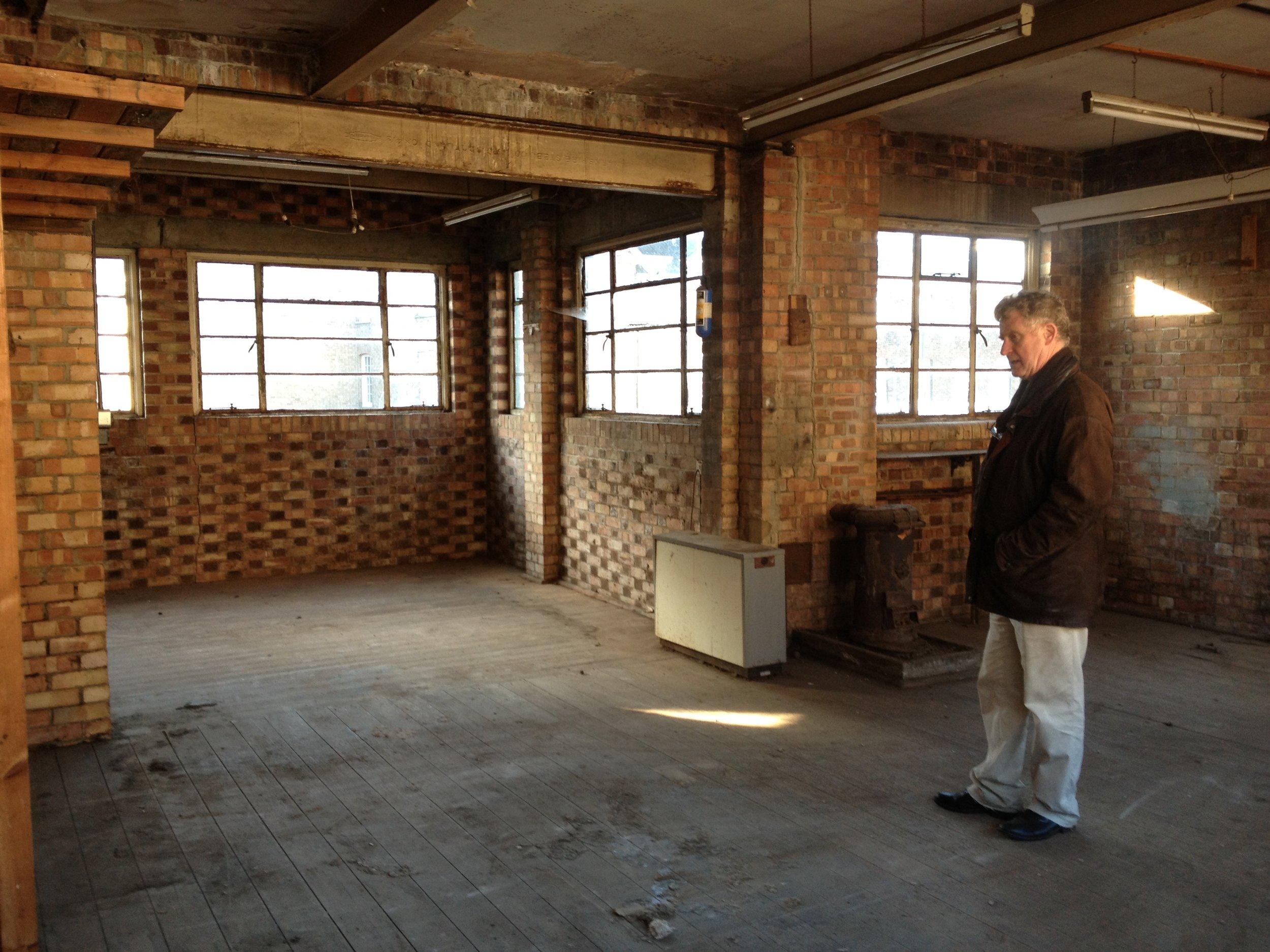 Sandy Heslop contemplating the empty upper floor before construction began.