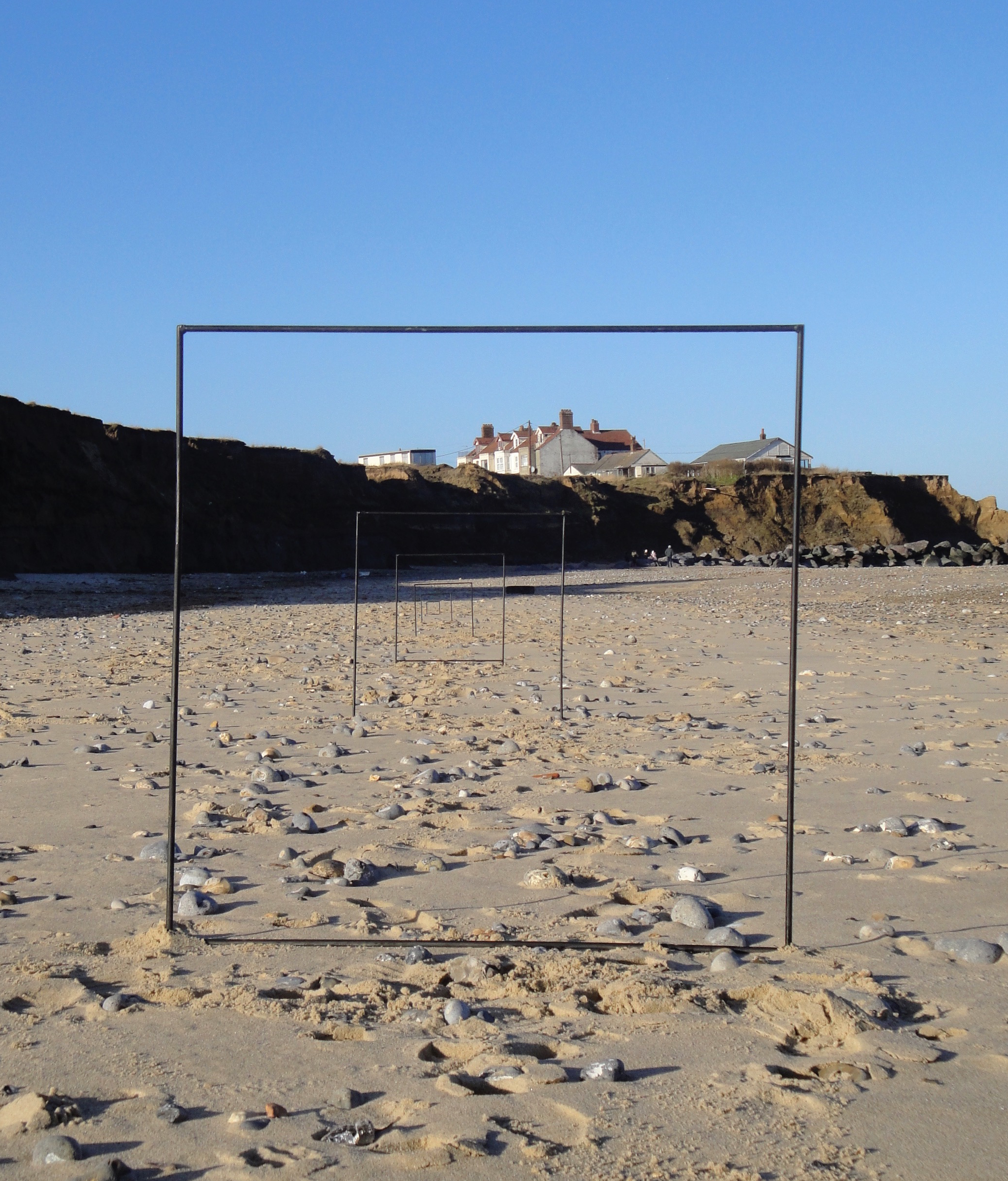 This image comes from an installation Kaitlin Ferguson made on Happisburgh beach in Norfolk, annually measuring its dramatic changes through climate change from 2014 onwards