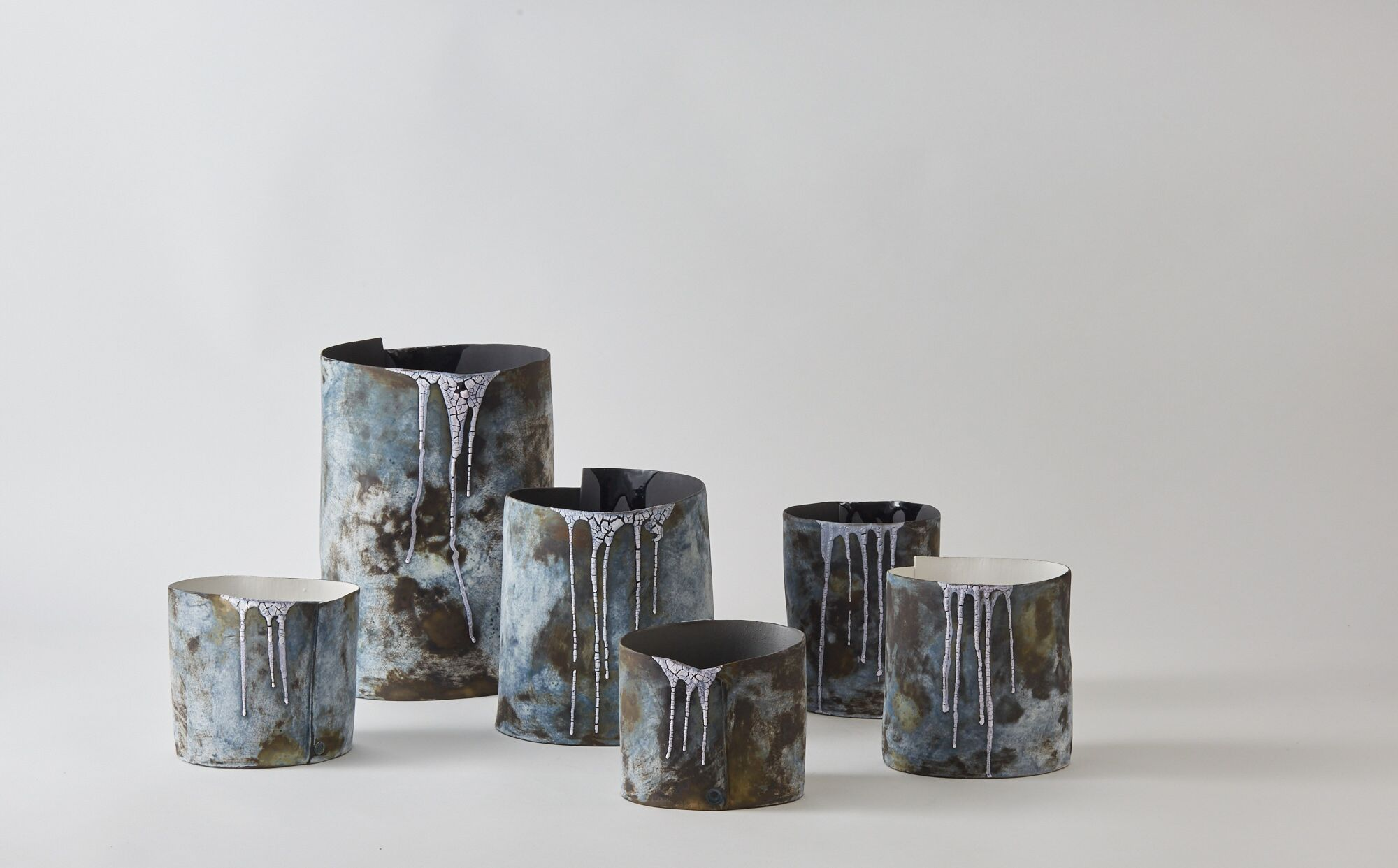 This is part of a collection of stoneware vessels made following the artist's visit to Iceland. It is a perfect medium to reflect her responses to that country's fragile, watery,changing landscapes.
