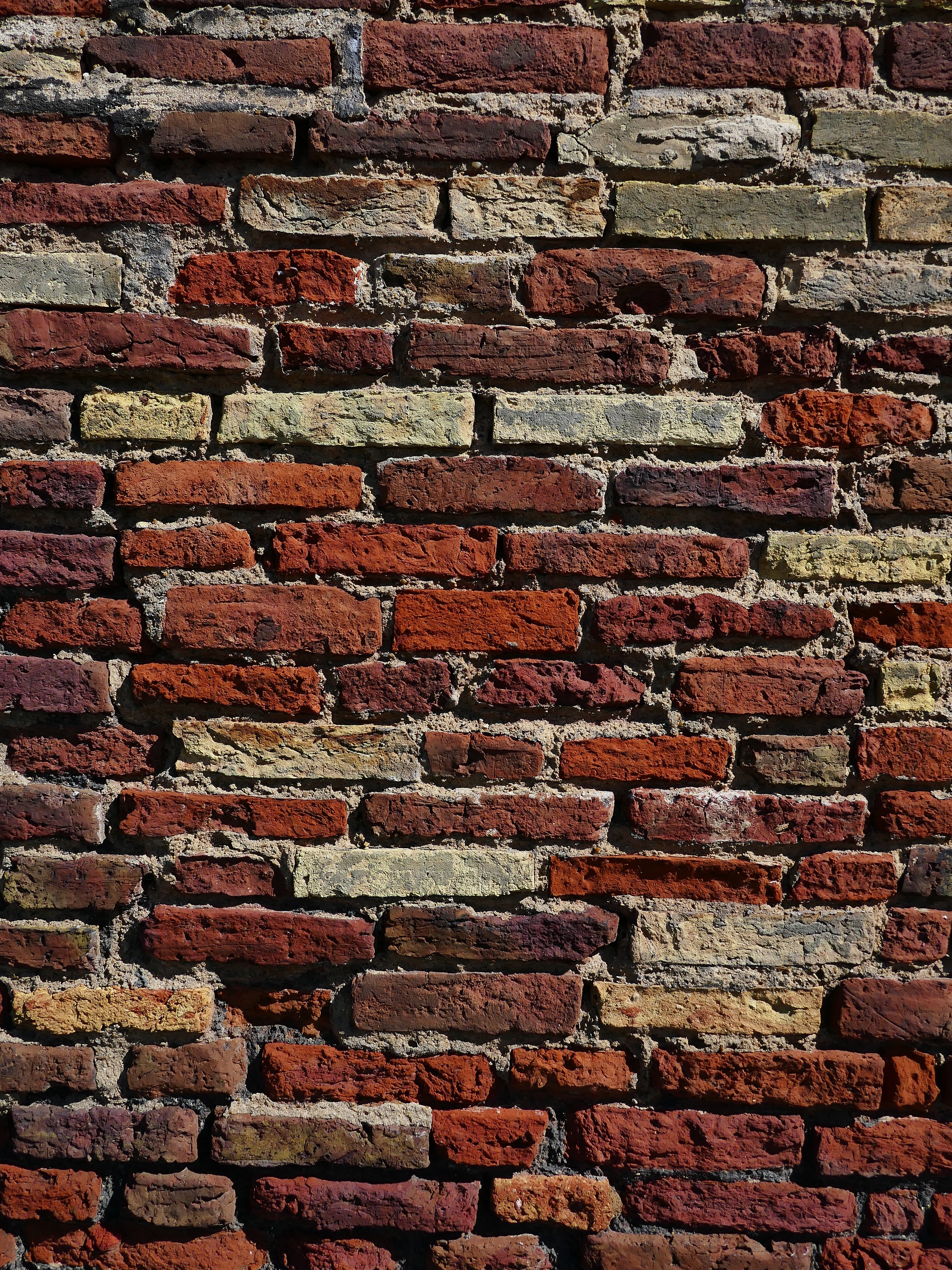 Bricks:  clay, formed into rectangular shapes and then baked in a kiln to make the material hard and durable.