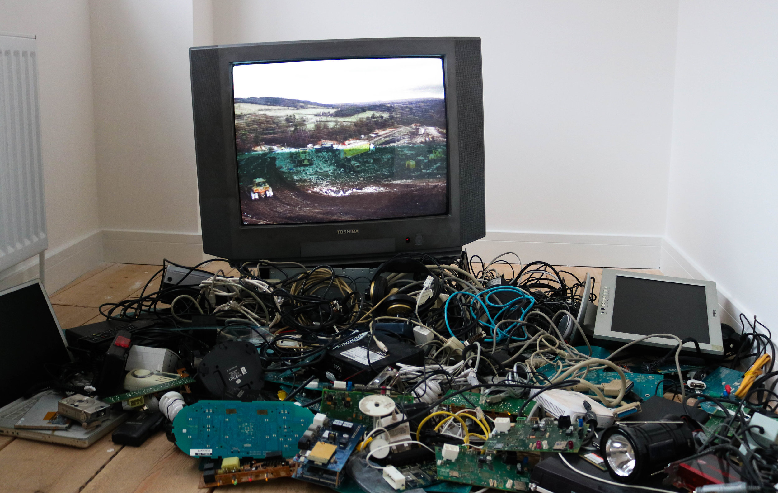 The Surrey Hills on display at GroundWork in an installation of electronic waste