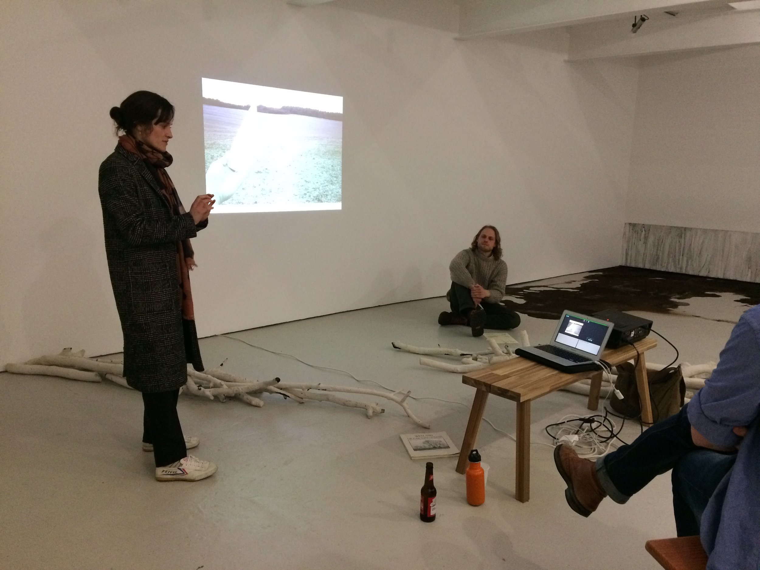 Lotte Scott giving a talk in her exhibition 'The Fields Are Seas' at Norwich Outpost Gallery, 2018.