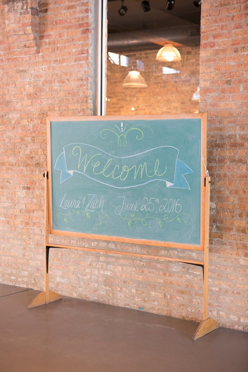 Old school chalkboard used as a welcome sign  Planning By Wrap It Up Parties  Artifact Events